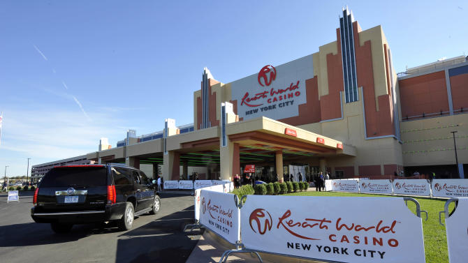 FILE - In this Oct. 28, 2011 file photo, the front entrance of the Resorts World Casino is shown on the day of its official opening as New York City's first casino at the Aqueduct Racetrack, in the Queens borough of New York. Seeking to increase state revenue an bolster sagging budgets and at the same time create jobs, New York Gov. Andrew Cuomo proposes to swap land for a global casino developer to build the nation's largest convention center in the New York City borough of Queens, while pushing for an amendment to the constitution to allow private sector casinos beyond Indian land, which is allowed and limited by federal law.  (AP Photo/Kathy Kmonicek, File)