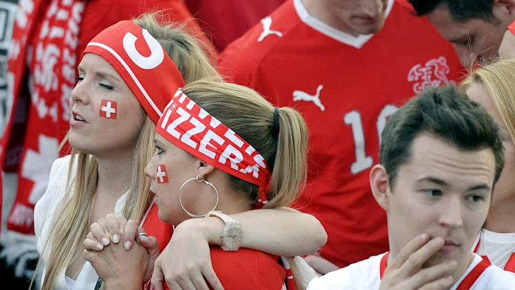 Swiss soccer fans react during the live broadcast of the Brazil Soccer FIFA World Cup match between Argentina and Switzerland at the public viewing WM-Lounge Europaallee in Zurich, Switzerland, Tuesday, July 1, 2014. (AP Photo/Keystone, Walter Bieri)