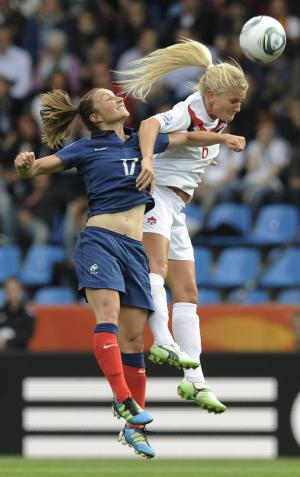 France's Gaetane Thiney, left, and Canada's Kaylyn Kyle challenge for the ball during the group A match between Canada and France at the Women's Soccer World Cup in Bochum, Germany, Thursday, June 30, 2011. (AP Photo/Martin Meissner)