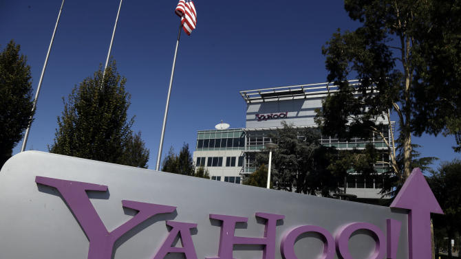 This Wednesday, Oct. 17, 2012, photo, shows a sign in front of Yahoo! headquarters in Sunnyvale, Calif., Wednesday, Oct.  17, 2012. Yahoo has ushered in Marissa Mayer as its new CEO with a third-quarter earnings report that topped analyst estimates. The results announced Monday Oct. 22, 2012, show Yahoo's net revenue barely grew at a time when advertisers are spending more money marketing their products and services online. Nevertheless, the numbers were slightly better than analysts projected. (AP Photo/Marcio Jose Sanchez)