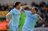 Mismanaged Aguero & Tevez typify Manchester City's crumbling title defence