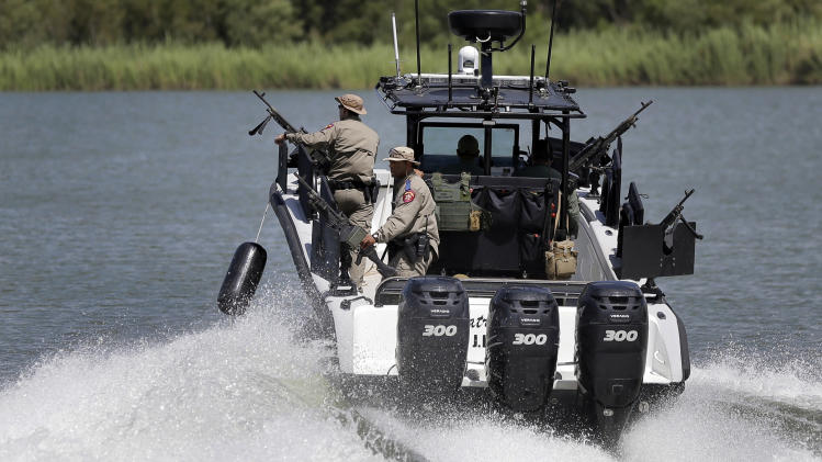Texas Department of Safety Troopers patrol on the Rio Grande along the U.S.-Mexico border
