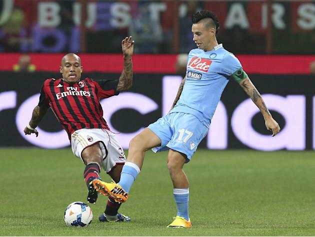 AC Milan midfielder Nigel de Jong, left, of the Netherlands, challenges Napoli midfielder Marek Hamsik, of Slovakia, during the Serie A soccer match between AC Milan and Napoli at the San Siro stadium