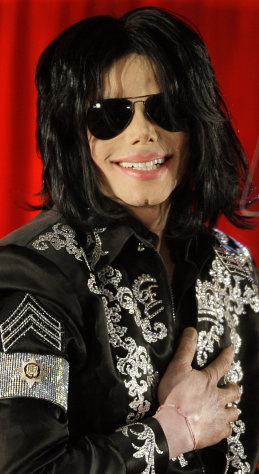 "FILE - In this March 5, 2009 file photo, US singer Michael Jackson announces that he is set to play ten live concerts at the London O2 Arena in July, which he announced at a press conference at the London O2 Arena. Some key figures who helped manage Michael Jackson's career are teaming up to create a musical about the behind-the-scenes making of a superstar that producers call a cross between ""Goodfellas"" and ""Dreamgirls."" ""The Man,"" with a book by Lamica and Grammy Award-winning composer Hart, is expected to open in Las Vegas in the late fall of 2013. (AP Photo/Joel Ryan, File)"