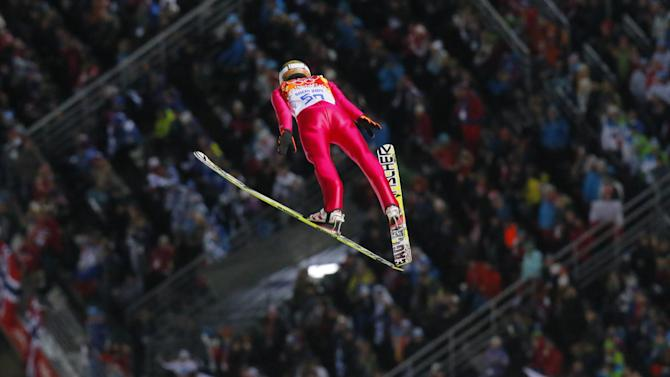 Stoch wins Olympic gold double in ski jumping