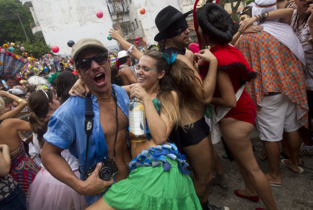 "People dance during the ""Ceu na Terra"" block carnival parade in Rio de Janeiro, Brazil, Saturday, Feb. 9, 2013. According to Rio's tourism office, Rio's street Carnival this year will consist of 492 b"