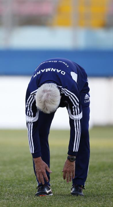 Denmark's national soccer team coach Morten Olsen stretches during a team training session in Ta' Qali