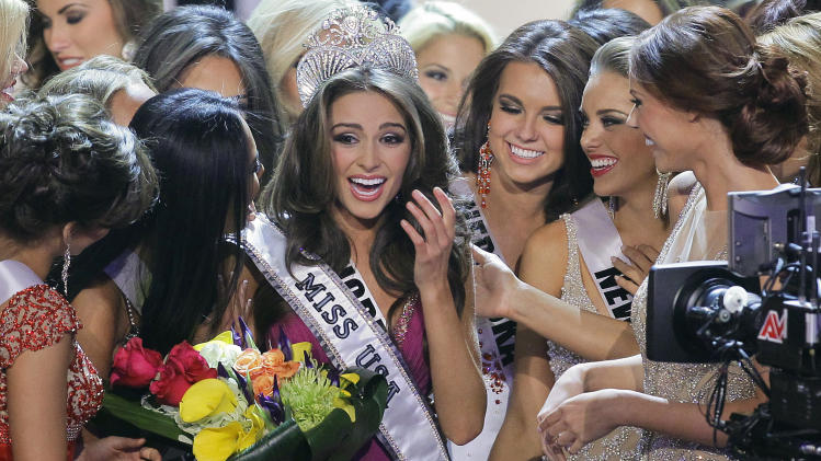 Miss Rhode Island Olivia Culpo, center, is surrounded by fellow contestants after being crowned Miss USA during the 2012 Miss USA pageant, Sunday, June 3, 2012, in Las Vegas. (AP Photo/Julie Jacobson)