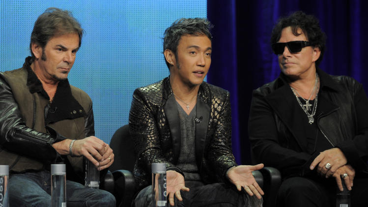 "FILE - This Aug. 6, 2013 file photo shows members of the band Journey, from left, Jonathan Cain, Arnel Pineda, and Neal Schon during a panel discussion on the Independent Lens documentary ""Don't Stop Believin': Everyman's Journey,"" at the PBS Summer 2013 TCA press tour in Beverly Hills, Calif. Journey is donating $350,000 to help relief efforts in the Philippines, and its lead singer has a message for his homeland, ""Don't Stop Believin'."" Arnel Pineda and the rest of the band announced the donation on Friday, Nov. 15, 2013. It will go to the United Nations World Food Programme, which is providing Filipinos with food assistance. The donation should provide 1.4 million meals. (Photo by Chris Pizzello/Invision/AP, File)"
