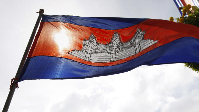 A Cambodian flag flutters in front of the Peace Palace ahead of the ASEAN Summit and related meetings in Phnom Penh, Cambodia, Saturday, Nov. 17, 2012.  (AP Photo/Vincent Thian)