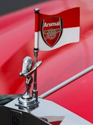 A Rolls Royce is decked in Arsenal regalia parked on the streets close to the stadium