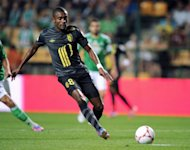 Lille's Ivorian forward Salomon Kalou runs with the ball during the French L1 football match AS Saint-Etienne vs Lille OSC on August 11 at the Geoffroy Guichard stadium in Saint-Etienne. Kalou is injured and will miss his country's 2013 Africa Cup of Nations qualifier against Senegal on October 13.