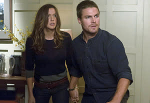 Katie Cassidy and Stephen Amell | Photo Credits: Jack Rowand/The CW