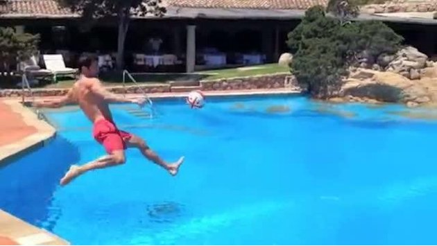 Fabregas volleys by the pool