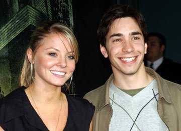 Kaitlin Doubleday and Justin Long at the Hollywood premiere of MGM's The Amityville Horror