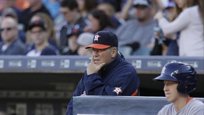 Houston Astros first base coach Rich Dauer watches their baseball game against the Detroit Tigers from the dugout steps Friday, May 22, 2015, in Detroit. (AP Photo/Duane Burleson)