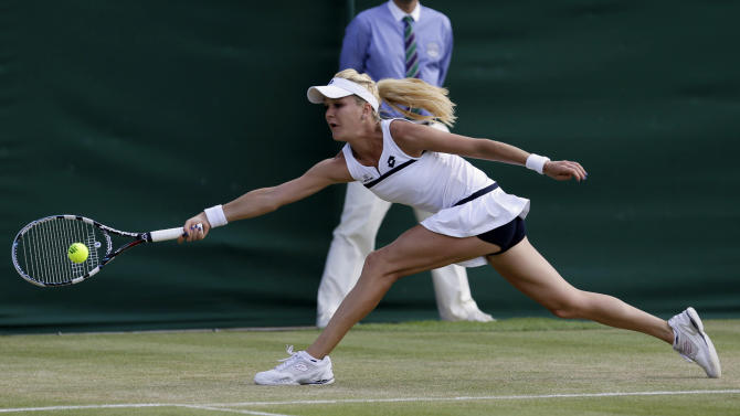 Agnieszka Radwanska of Poland returns to Tsvetana Pironkova of Bulgaria during their Women's singles match at the All England Lawn Tennis Championships in Wimbledon, London, Monday, July 1, 2013. (AP Photo/Anja Niedringhaus)