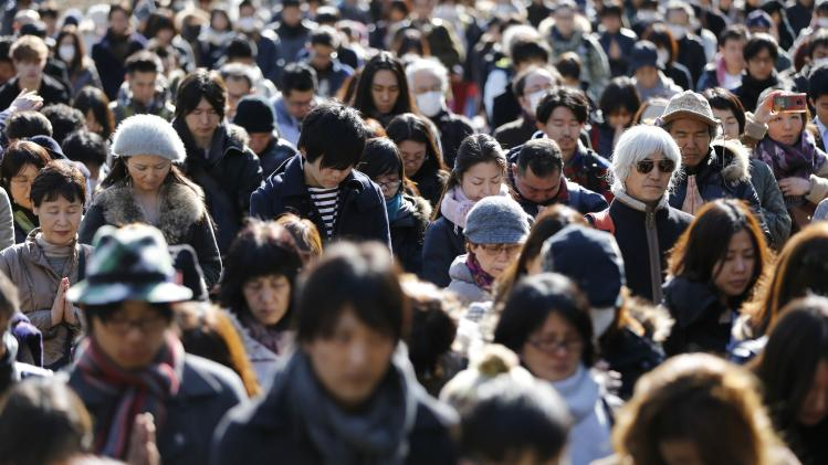 People observe a moment of silence during a rally at 2:46 p.m. (0546 GMT), the time when the magnitude 9.0 earthquake struck off Japan's coast in 2011, in Tokyo