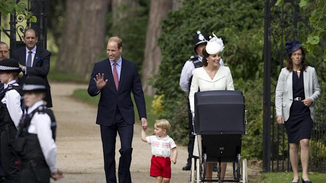 Britain's Prince William, Kate the Duchess of Cambridge, their son Prince George and daughter Princess Charlotte in a pram arrive for Charlotte's Christening at St. Mary Magdalene Church in Sandringham, England, Sunday, July 5, 2015.  (AP Photo/Matt Dunham, Pool)