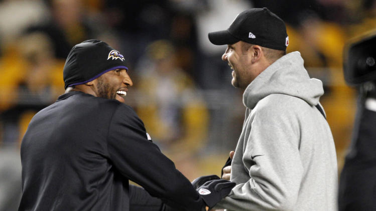 Baltimore Ravens inside linebacker Ray Lewis, left, greets Pittsburgh Steelers quarterback Ben Roethlisberger as their two teams warm up before an NFL football game, Sunday, Nov. 18, 2012, in Pittsburgh. Neither played due to injury. (AP Photo/Keith Srakocic)