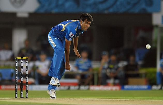 Mumbai Indians  Munaf Patel bowls during the IPL Twenty20 cricket match between Deccan Chargers and Mumbai Indians at Dr. Y.S. Rajasekhara Reddy Cricket Stadium in Visakhapatnam on April 9, 2012. AFP