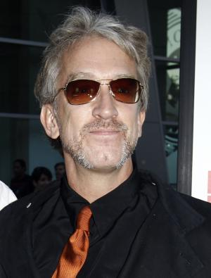 """FILE - In this Aug. 5, 2010 file photo, actor Andy Dick arrives at the premiere of """"Middle Men"""" in Los Angeles. Two Kentucky men who say they were sexually assaulted by comedian Andy Dick at a West Virginia nightclub two years ago have filed a lawsuit against the comedian. Dick pleaded not guilty last summer to charges he grabbed a bouncer's crotch, and groped and kissed a patron while performing a series of shows in Huntington at a comedy club. The alleged acts occurred Jan. 23, 2010, at the Rum Runners nightclub. (AP Photo/Matt Sayles, file)"""