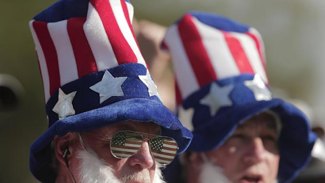 Fans watch on the 14th hole during a four-ball match at the Ryder Cup PGA golf tournament Friday, Sept. 28, 2012, at the Medinah Country Club in Medinah, Ill. (AP Photo/Charlie Riedel)