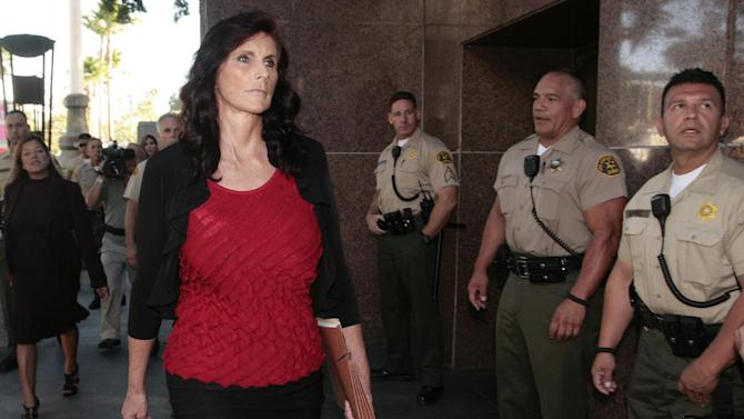 """Cindy Lee Garcia, left, one of the actresses in """"Innocence of Muslims,"""" arrives for a hearing at Los Angeles Superior Court in Los Angeles, Thursday, Sept. 20, 2012. Garcia is asking a judge to issue an injunction demanding the 14-minute trailer for """"Innocence of Muslims"""" be pulled from YouTube. (AP Photo/Jason Redmond)"""