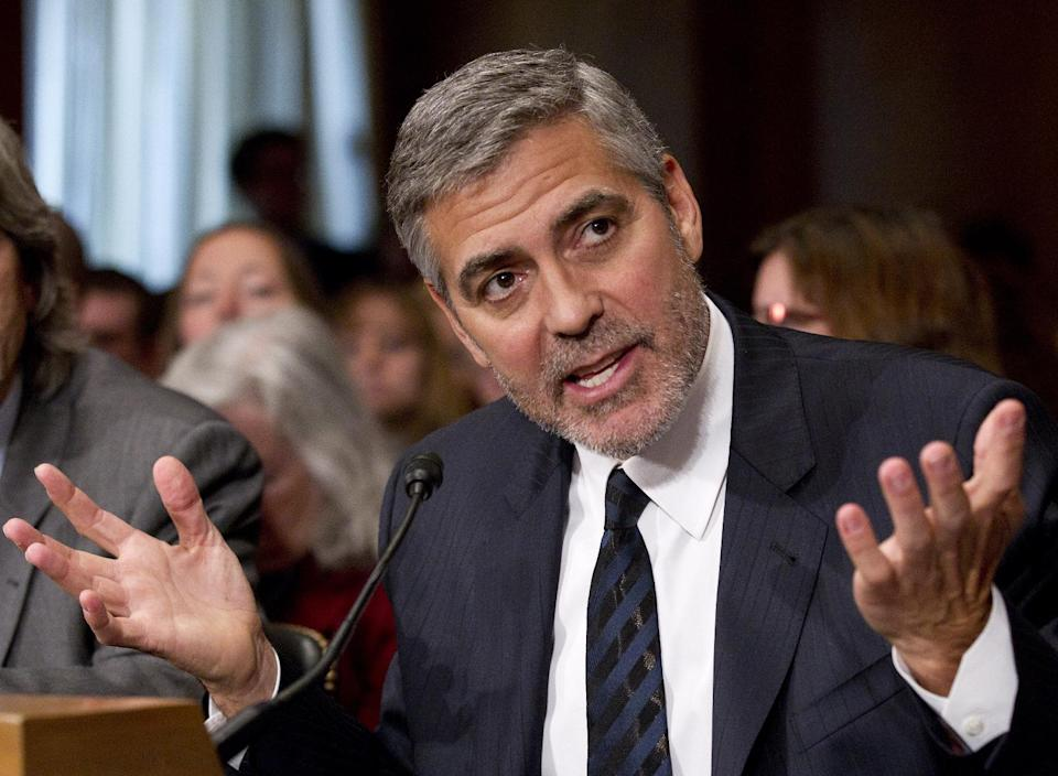 Actor George Clooney testifies on Capitol Hill in Washington, Wednesday, March 14, 2012, before the Senate Foreign Relations Committee hearing on Sudan.  (AP Photo/Manuel Balce Ceneta)