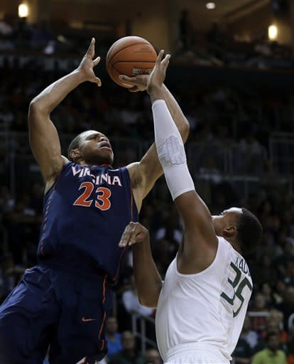 Johnson helps No. 2 Miami edge Virginia 54-50