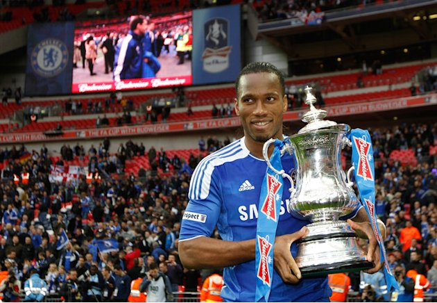 Chelsea's Ivorian Striker Didier Drogba Celebrating With The Cup AFP/Getty Images