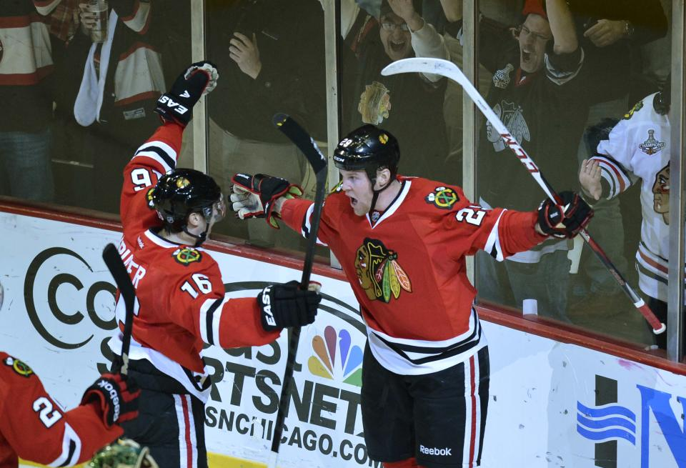 Chicago Blackhawks center Marcus Kruger of Sweden, left, and left wing Bryan Bickell celebrate after Bickell scored during the first period of an NHL hockey game against the Minnesota Wild, Tuesday, March 5, 2013 in Chicago.  (AP Photo/Brian Kersey)