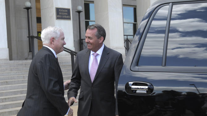 Defense Secretary Robert Gates walks British Defense Minister Liam Fox to his car after they made a joint statement at the Pentagon, Tuesday, April 26, 2011. (AP Photo/Susan Walsh)