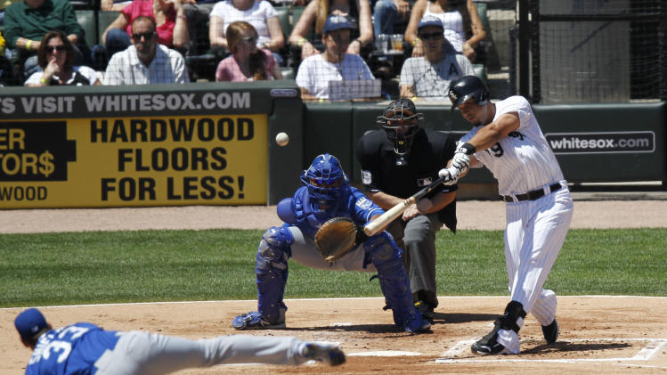 Chicago White Sox's Jose Abreu hits a double off Kansas City Royals' James Shields during the first inning of a baseball game Wednesday, July 23, 2014, in Chicago. (AP Photo/Stacy Thacker)