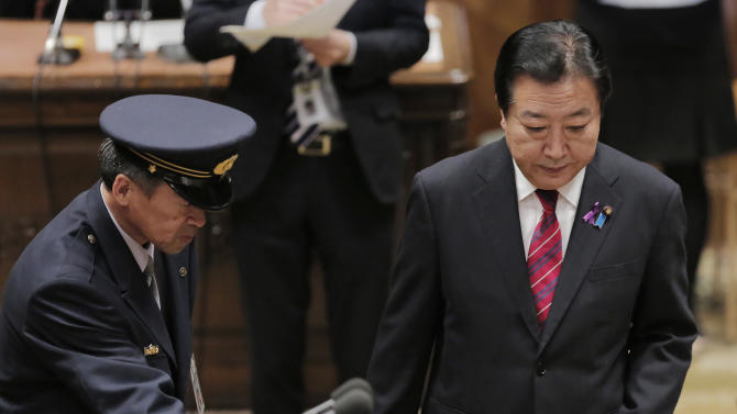 Japanese Prime Minister Yoshiko Noda arrives at a debate with Japan's main opposition Liberal Democratic Party President Shinzo Abe at Parliament in Tokyo, Wednesday, Nov. 14, 2012. During the heated parliamentary exchange with Abe, Noda said that he is ready to dissolve the parliament by Friday, bringing an election within weeks, if Japan's main opposition party agrees to key electoral reforms. (AP Photo/Itsuo Inouye)