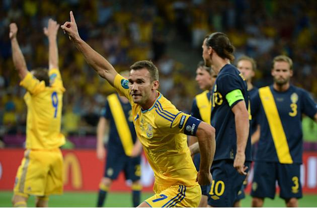 Ukrainian Forward Andriy Shevchenko (C) Celebrates AFP/Getty Images