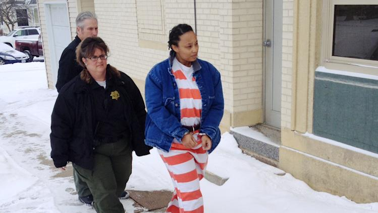In this image from video provided by KCRG TV, Kristen Smith arrives for a hearing Friday, Feb. 14, 2014 in Tipton, Iowa. Smith, charged with kidnapping her half sister's newborn from Wisconsin, waived the right to challenge her extradition on a warrant from Texas charging her with tampering with government records. Federal prosecutors could take her into custody at any time in the kidnapping case. (AP Photo/KCRG TV, Mark Carlson)