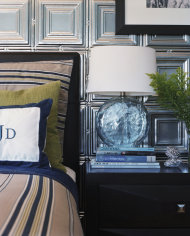 This publicity photo provided by courtesy of Live Well Designs shows a master bedroom designed by Kyle Schuneman of Live Well Designs, with a bedside table reminiscent of a melting chunk of ice and a wall lined with shimmery, metal ceiling tiles bringing some frosty winter style to a southern California home. (AP Photo/Courtesy of Live Well Designs, Joe Schmelzer)