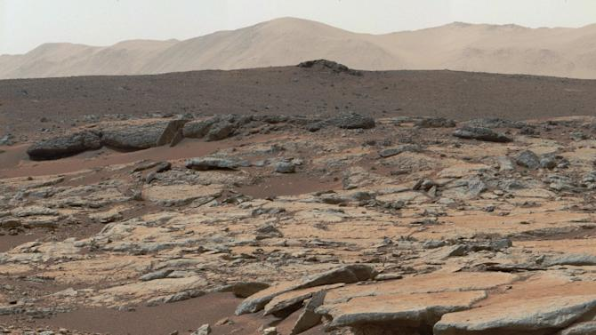 The Mast Camera (Mastcam) instrument on NASA's Curiosity Mars rover shows a series of sedimentary deposits in the Glenelg area of Gale Crater