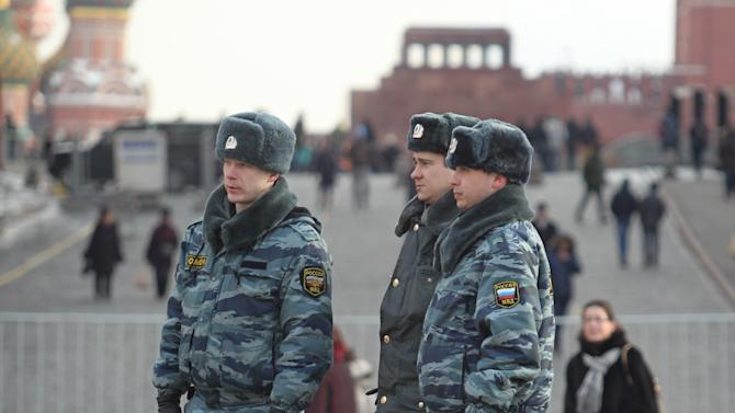 Russian police officers patrol at Red Square with the Lenin Mausoleum in the background, in Moscow, Russia, Saturday, March 3, 2012. Security is tightened on the eve of Sunday's presidential election in Russia. (AP Photo/Mikhail Metzel)