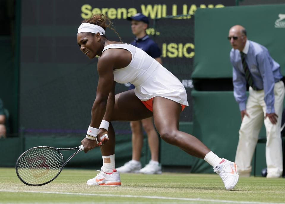 Serena Williams of the United States follows through on a return during her Women's singles match against Sabine Lisicki of Germany at the All England Lawn Tennis Championships in Wimbledon, London, Monday, July 1, 2013. (AP Photo/Alastair Grant)