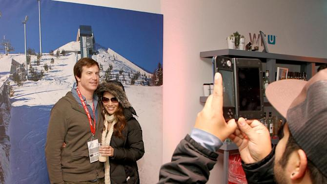 Actors Rob Huebel, left, and Holly Hannula have 3D photos taken at the Nintendo Lounge with Nintendo 3DS XL during a break from the Sundance Film Festival on Saturday, January 20, 2013 in Park City, UT. (Photo by Donald Traill/Invision for Nintendo/AP Images)