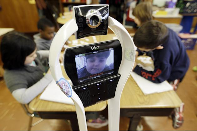 In this Thursday, Jan. 24, 2013 photo, Devon Carrow attends Winchester Elementary School from home while operating a robot in the classroom, in West Seneca N.Y. Carrow's life-threatening allergies don