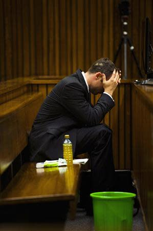 Oscar Pistorius sits in dock during court proceedings at the North Gauteng High Court in Pretoria