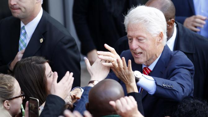 Former U.S. President Clinton shakes hands with campaign supporter after speaking about Kentucky's Democratic Senate candidate Grimes during campaign event at Muhammad Ali Center in Louisville