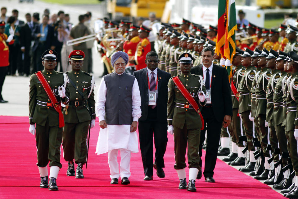 Indian Prime Minister Manmohan Singh inspects a guard of honor after his arrival in Addu, Maldives, Wednesday,  Nov. 9, 2011. The heads of eight South Asian Association for Regional Cooperation (SAARC) countries are meeting in this Indian Ocean archipelago on Nov. 10 and 11. (AP Photo/Sinan Hussain)