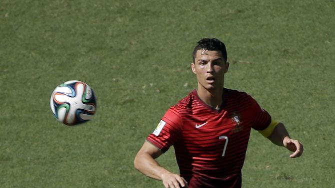 Portugal's Cristiano Ronaldo eyes the ball during the group G World Cup soccer match between Germany and Portugal at the Arena Fonte Nova in Salvador, Brazil, Monday, June 16, 2014