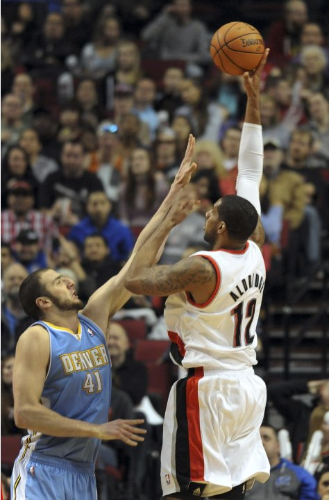 Portland Trail Blazers power forward Aldridge shoots the ball over Denver Nuggets center Koufos during the fourth quarter of their NBA basketball game in Portland