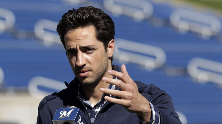 FILE - In this Feb. 24, 2012 file photo, Milwaukee Brewers' Ryan Braun speaks during a news conference at baseball spring training in Phoenix. The 2011 National League MVP was suspended without pay for the rest of the season and the postseason Monday, July 22, 2013, the start of sanctions involving players reportedly tied to a Florida clinic accused of distributing performance-enhancing drugs. (AP Photo/Jae C. Hong, File)