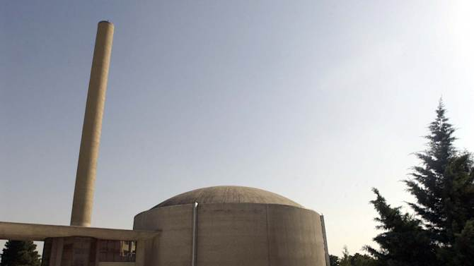 FILE-In this file photo taken on Saturday, June 21, 2003, the building of Tehran's nuclear research reactor is seen at the Iran's Atomic Energy Organization's headquarters, in Tehran, Iran. In a bid by Iran to ease international concerns over its nuclear program, more than a third of Tehran's most highly enriched uranium has been converted into a powder that is used to run a research reactor but  difficult to reprocess for possible weapons production, experts and U.N. monitors say. The work _ noted in a technical report by the U.N.'s nuclear watchdog agency in late August _ suggests a two-prong effort by Iran: Trying to display goodwill to restart nuclear talks with world powers while seeking to soften demands by the U.S. and others to halt Tehran's top-level uranium enrichment. (AP Photo/Vahid Salemi, File)